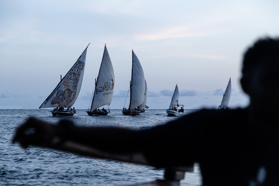 Dhows sail home to Lamu Island from the surrounding coastline at dusk.