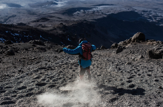 Hussein Saidi, a guide on Kilimanjaro, on his victory slide down the scree-slopes of Kibo Crater after another successful summit.