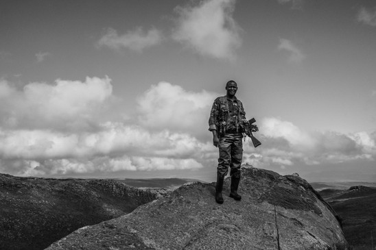 Tom, a game ranger with the Kenya Wildlife Service, stands over the remote moorlands of the Aberdares range.