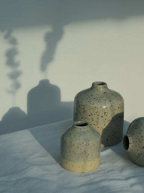 handmade speckled bud vase | transparent blue glaze