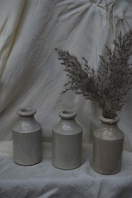 vintage cream stoneware bottles