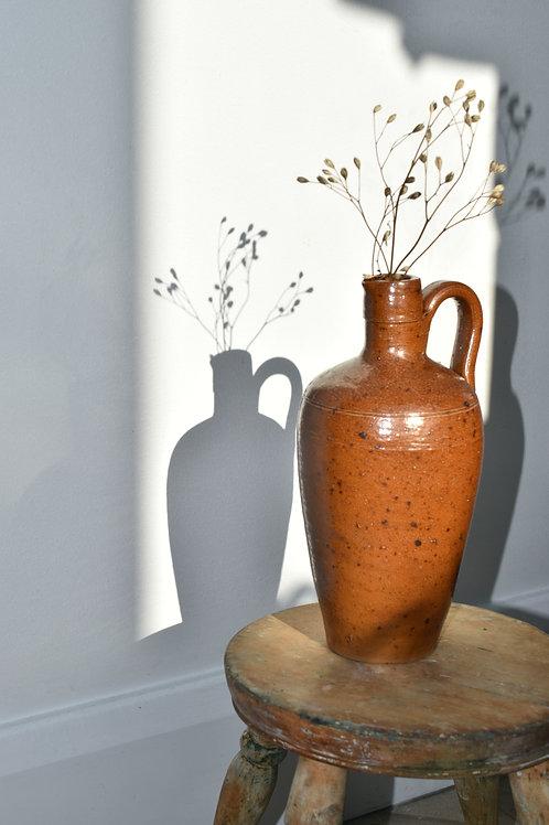 vintage salt-glazed stone bottle