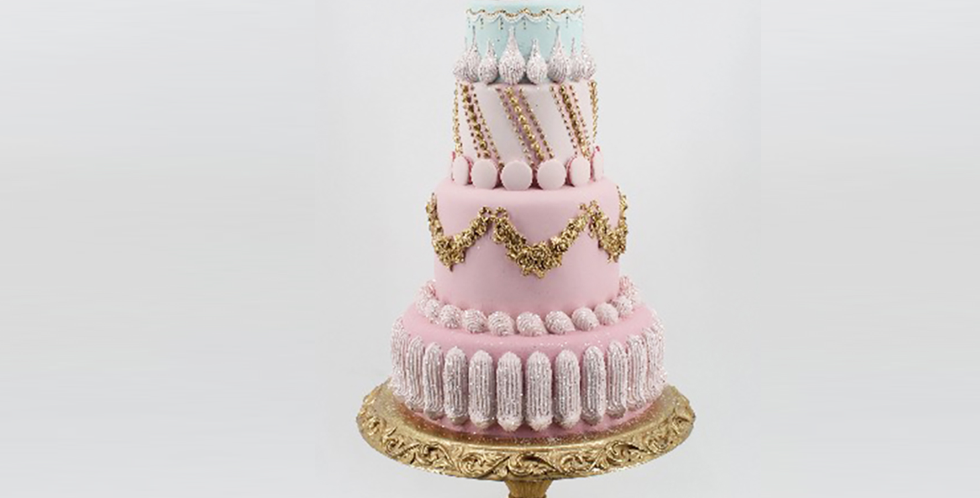 Pink Tiered Decorated Cake on Gold Base Decor