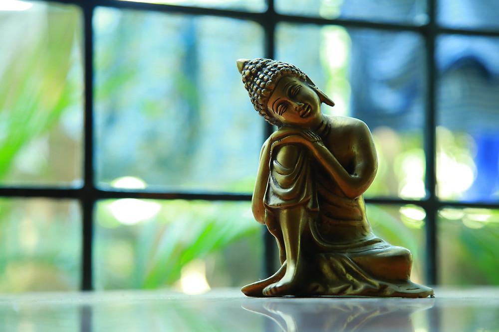 Brass Buddha Statuette by Wilsan U on Unsplash