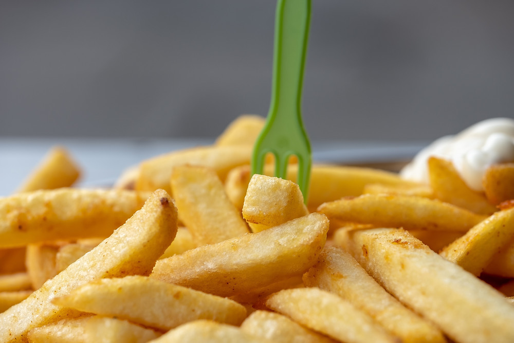 Plate of chips with a fork jabbed in it