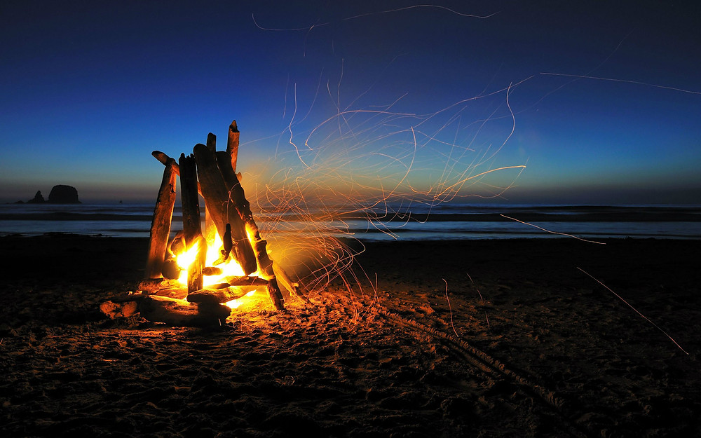 Beach bonfire at dusk