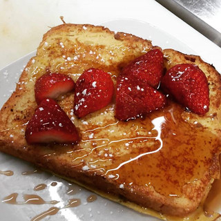 French Toast topped with Real Maple Syrup and Strawberries
