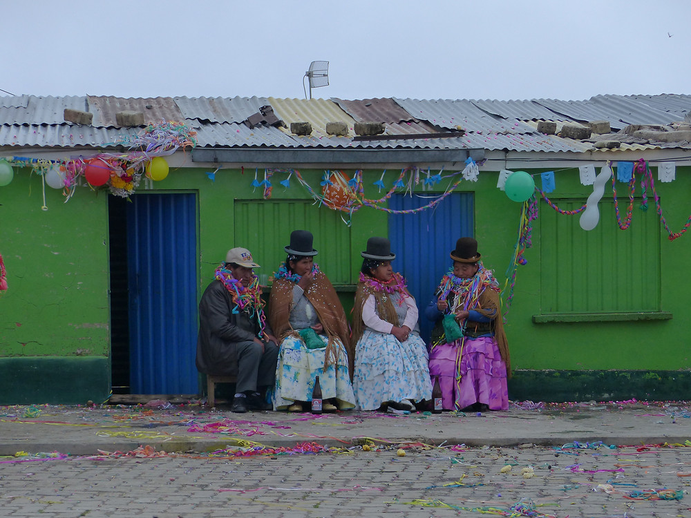 El Alto in Bolivia, ladies and man celebrate carnaval - Vagabond Journals