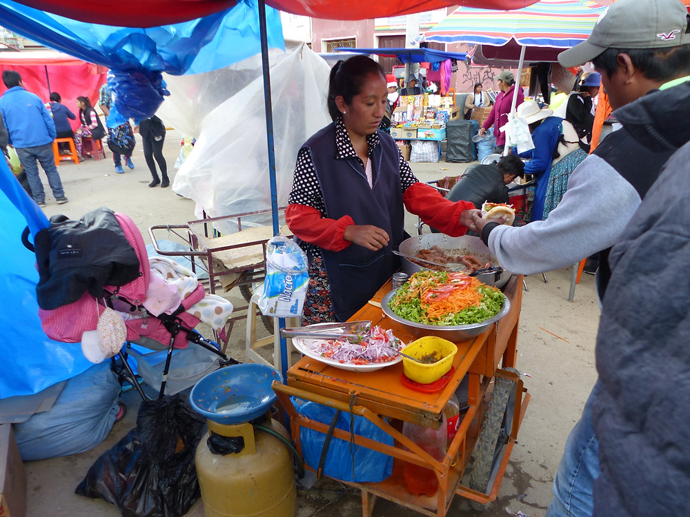 Food Stall at Oruro Carnaval - Vagabond Journals