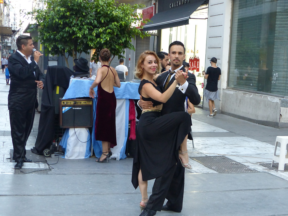 Tango dancers giving a show on a street corner in Buenos Aires