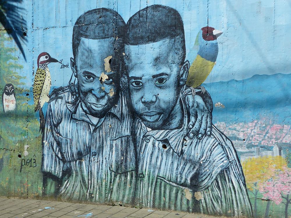 Colombia Comuna 13 street graffiti 2 boys - Vagabond Journals