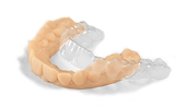 clear aligner resting on its 3D-printed model