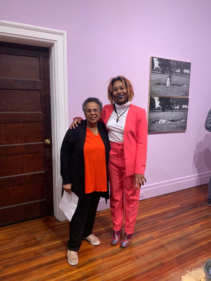 Artist/Curator Mahari Chabwera  hugging her Oma - Kathleen Harmon