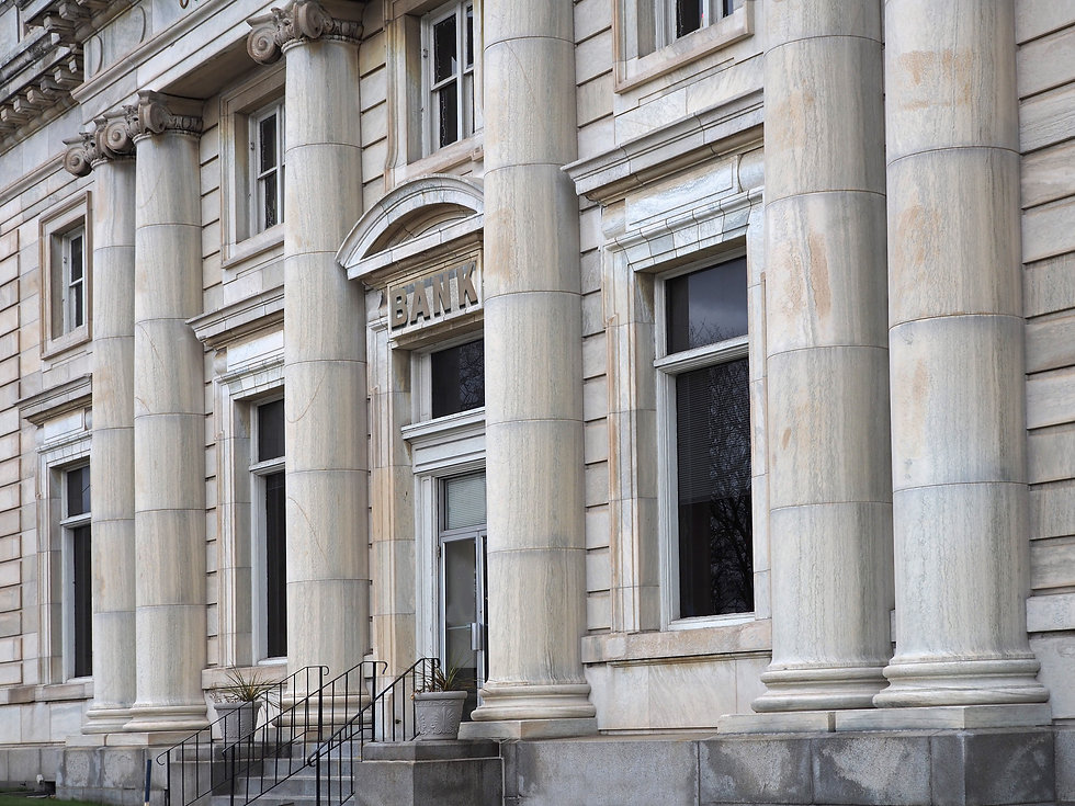 Old stone bank building with columns.jpg