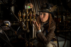 Steampunk mechanic checking the oil