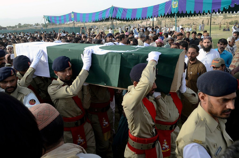 Pakistani troops in Quetta carry the coffin, wrapped in the national flag, of the provincial candidate Siraj Raisani, who was killed in Friday's suicide bombing in Mastung.CreditArshad Butt/Associated Press