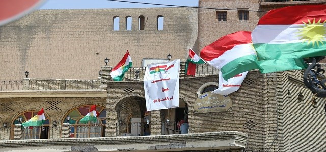 """Flags of Kurdistan and a poster reading """"Yes to referendum"""" hanging on the walls of Erbil's ancient citadel. Photo by Farzin Hassan/Rudaw"""