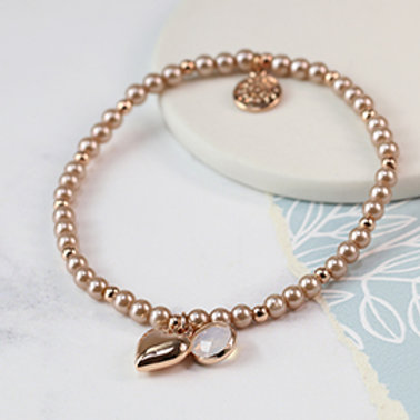Pom pink pearl bracelet with rose gold heart and smoky crystal
