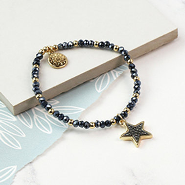 Pom dark bead and golden star bracelet with sparkle centre