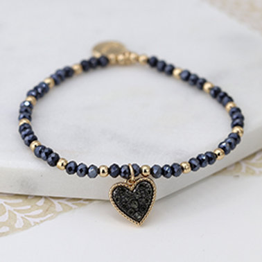 Pom black crystal and golden bead bracelet with heart charm