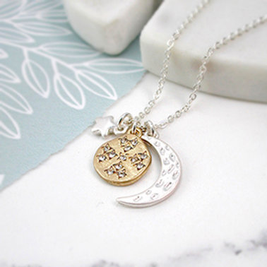 Pom silver plated moon, star and golden crystal planet necklace