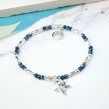 Pom blue bead bracelet with silver crystal starfish