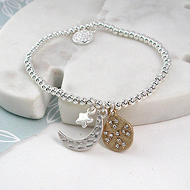 Pom silver plated moon, star and golden crystal disc bracelet