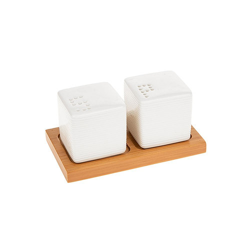 White Salt and Pepper Shakers on a Wooden Stand
