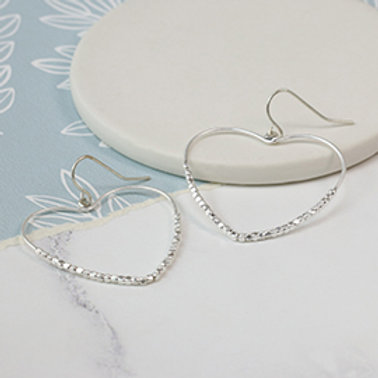Pom silver plated heart shaped earrings with beaded detailing