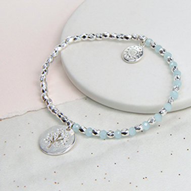 Pom silver plated and aqua bead bracelet with tree disc charm