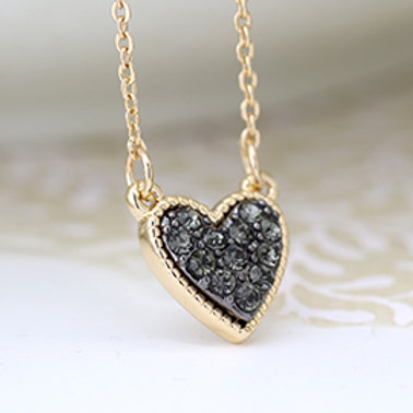 Pom gold plated heart necklace with black crystal center