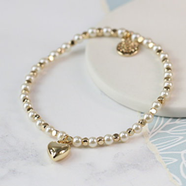 Pom pearl and golden bead bracelet with gold plated heart