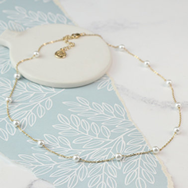 Pom gold plated fine chain necklace with white faux pearls