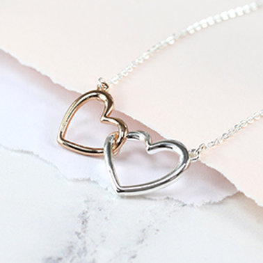 Pom silver and rose gold plated linked hearts necklace