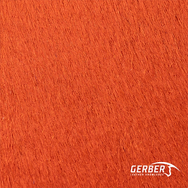 Couro estampado cor laranja e pelo, utilizado em tapetes e itens decorativos divesos.