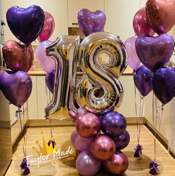 Silver and purple number tower