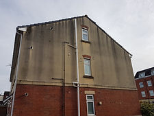 House with dirty render before cleaning