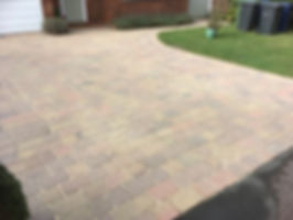 Block paved driveway after pressure washing and resanding