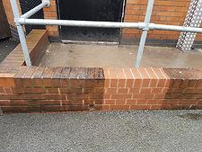 Dirty brick half way through cleaning
