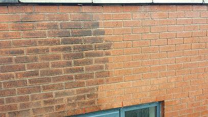 Brickwork halfway through cleaning