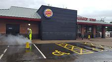 Burger King parking area being pressure washed