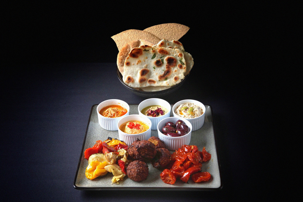Selection of mezze/antipasti all vegan and glutenfree. Selection of gluten-free flatbreads