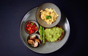 Smashed avocado on toasted sourdough, chargrilled asparagus, balsamic roasted mushrooms, salsa and freerange scrambled eggs