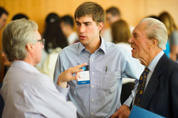 Attendees talk with speakers