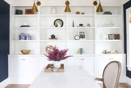 white bookcase with gold lighting.jpg