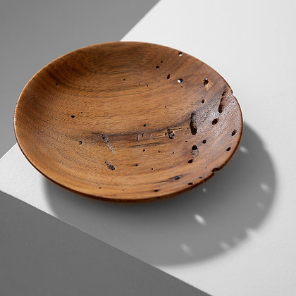 Unique handmade artisan bowl made from wormy butternut wood