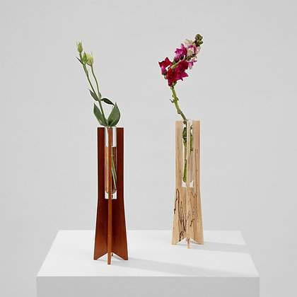 Dark wood and light reclaimed wood bud vases made of small glass beakers and two-part handmade wooden base