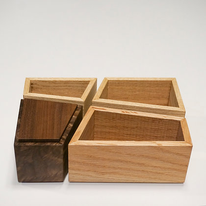 A set of four handmade artisan wooden boxes