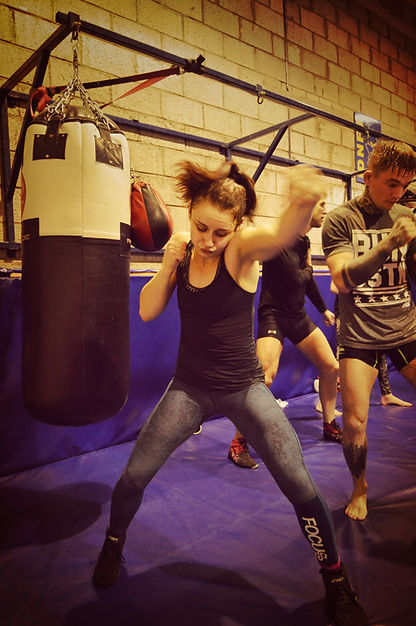 MMA class at Higher Level MMA, featuing female MMA star Fee Chrystal, ladies classes available