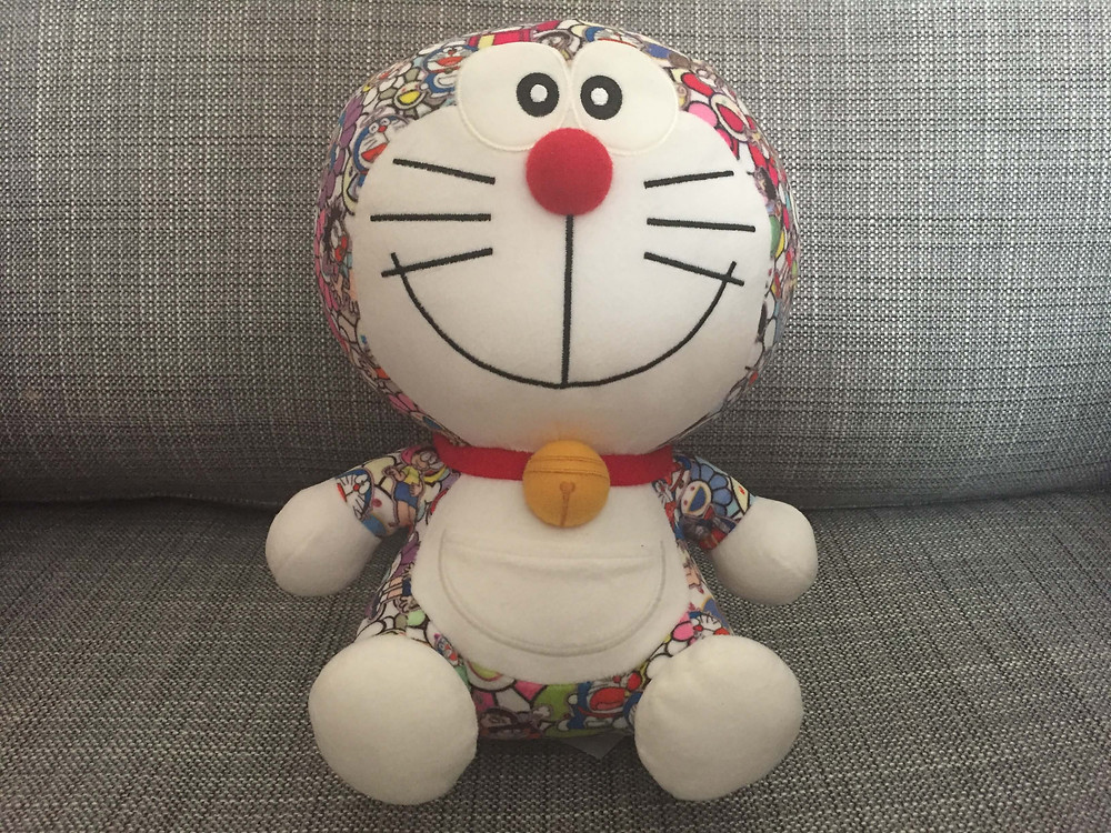 """His name is """"Doraemon."""" This Doraemon wears a fashionable outfit like an artist."""